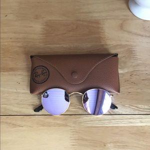 purple tinted reflective Ray Bans
